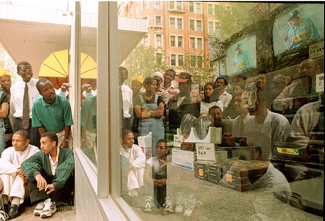 South African cricket fans watch outside an appliance store as their team loses another wicket in the 1996 Cricket World Cup quarter-final against the West Indies on March 11 1996. South Africa eventually lost the match