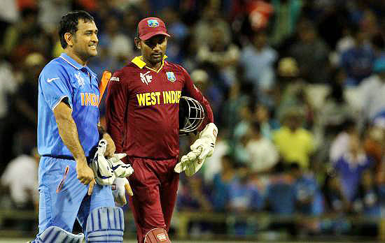 Mahendra Singh Dhoni and Denesh Ramdin walk off the field after the match