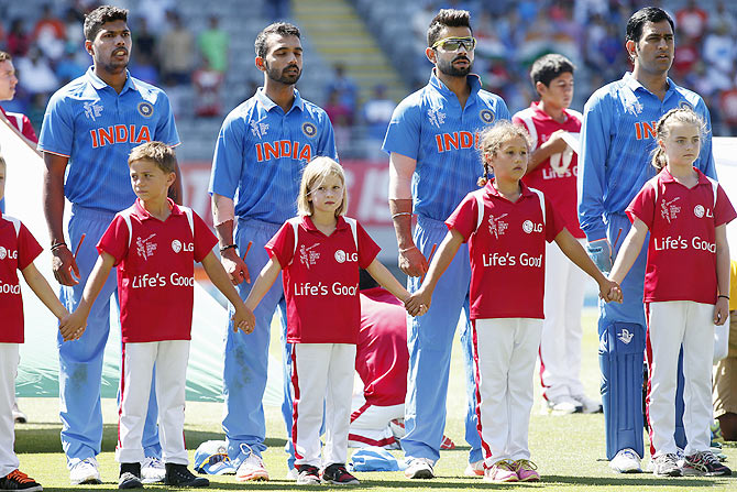 The India team sing the national anthem before the match against Zimbabwe
