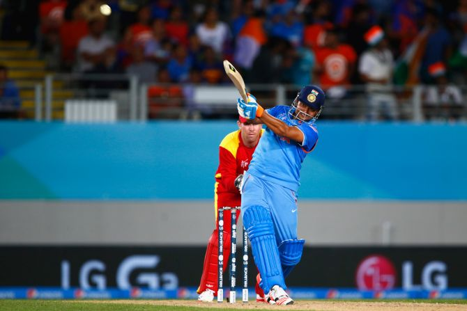 Suresh Raina during India's game against Zimbabwe at Eden Park in Auckland, on March 14, 2015 . Photograph Phil Walter/Getty Images