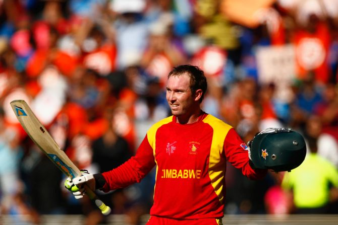 Brendan Taylor salutes the crowd as he leaves the field after scoring 138 runs. Photograph: Phil Walter/Getty Images
