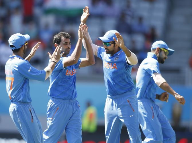 Mohammed Shami celebrates after dismissing Chamu Chibhabha. Photograph: Nigel Marple/Reuters