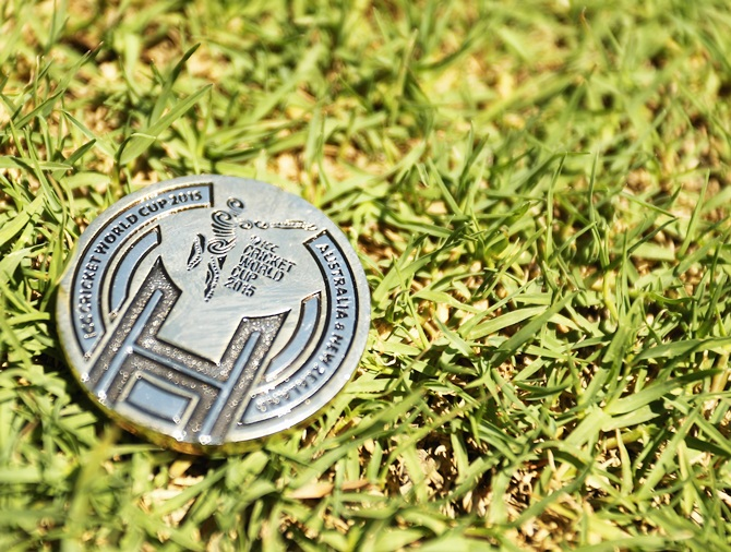 A commemorative coin used for the toss is seen prior to the start of play during the 2015 ICC   Cricket World Cup match