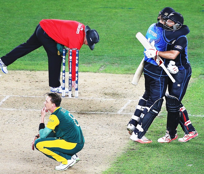 Dale Steyn is heartbroken as Daniel Vettori and Grant Elliott celebrate New Zealand's maiden entry into a World Cup final. Photograph: Hannah Peters/Getty Images