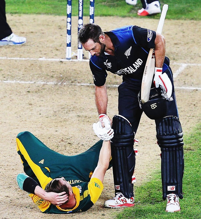 Grant Elliott, who scored a six off the penultimate delivery to win the match for New Zealand, helps South Africa pacer Dale Steyn off the ground at the end of their 2015 ICC World Cup semi-final on March 24