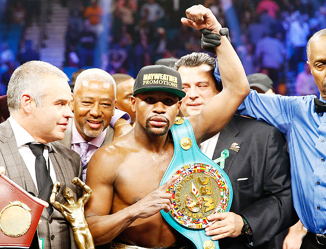 Rediff Sports - Cricket, Indian hockey, Tennis, Football, Chess, Golf - Mayweather maintains undefeated run after beating Pacquiao in megabout