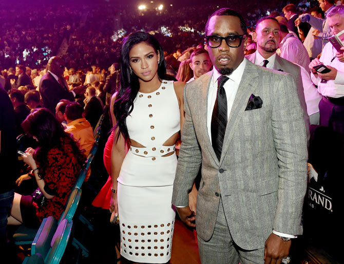 Model Cassie Ventura (left) and Sean 'Diddy' Combs pose ringside