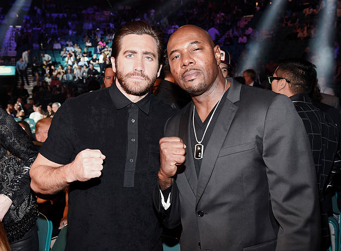 Actor Jake Gyllenhaal (left) and director Antoine Fuqua pose ringside