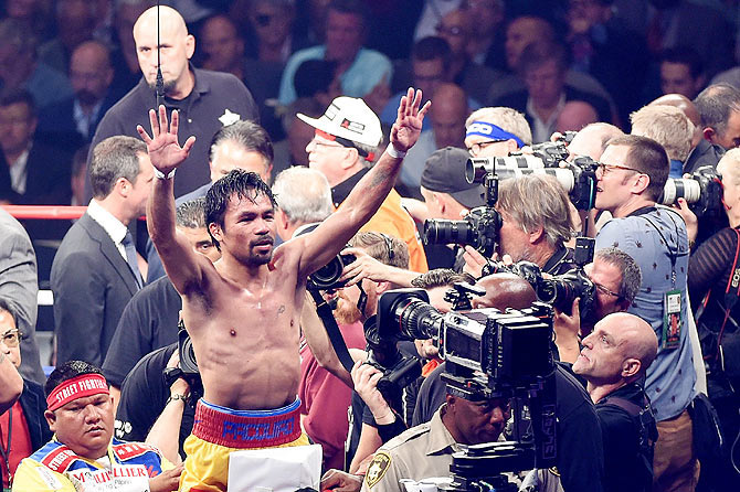 Manny Pacquiao gestures to the crowd after losing to Floyd Mayweather Jr