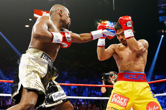 Rediff Sports - Cricket, Indian hockey, Tennis, Football, Chess, Golf - PHOTOS: How the Mayweather v Pacquiao bout was fought round-by-round