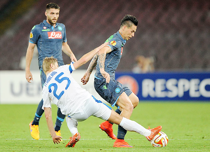 Marek Hamsik of Napoli is challenged by Valeriy Fedorchuk of FC Dnipro Dnipropetrovsk