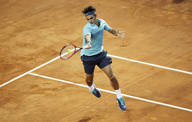 Switzerland's Roger Federer plays a return against Uruguay's Pablo Cuevas