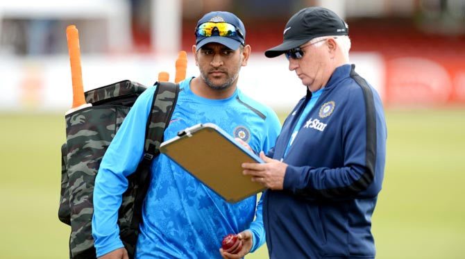 India captain Mahendra Singh Dhoni (left) with coach Duncan Fletcher