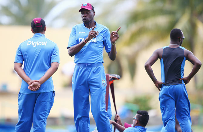 Curtly Ambrose (centre) the bowling coach of West Indies speaks to players during a nets session