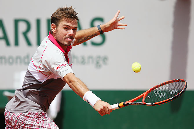 Stanislas Wawrinka of Switzerland plays a backhand against Marsel Ilhan of Turkey