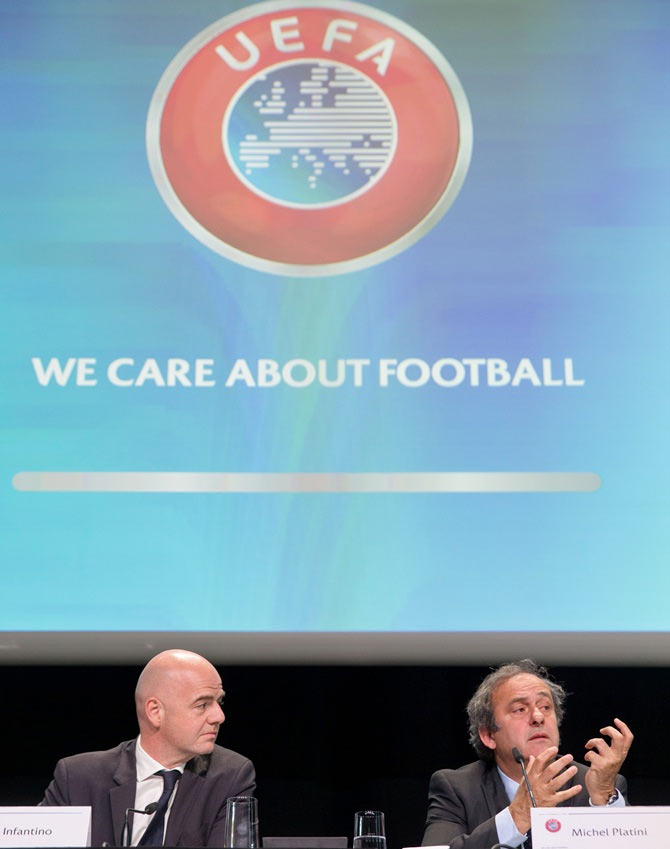 UEFA General Secretary Gianni Infantino, left, and UEFA president Michel Platini attend a press conference prior to the 65th FIFA Congress in Zurich