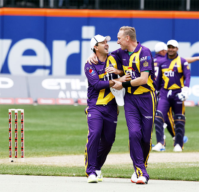 Ricky Ponting and Allan Donald share a light moment during the match
