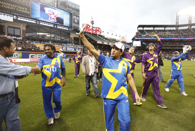 Muttiah Muralitharan, Sachin Tendulkar, Shane Warne and Wasim Akram acknowledge the crowd after the first Cricket All-Star T20 match in New York on Saturday