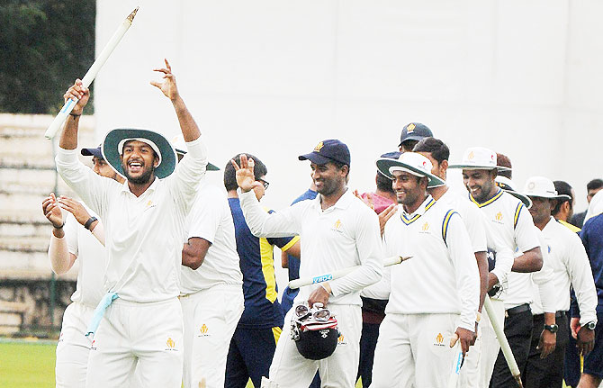 Karnataka Ranji team players celebrating after defeating Odisha by innings & 64 runs in Mysore on Tuesday