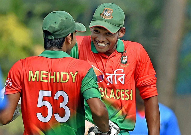 Bangladesh U-19 Captain Mehindy Hassan Miraz and his teammate Najmul Hossain Shanto celebrate after winning against Afghanistan