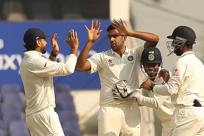 Ashwin high fives fellow Tamil Nadu player Murli Vijay while wicket-keeper Wriddhiman Saha and Cheteshwar Pujara exult Hashim Amla's wicket. Photograph: BCCI