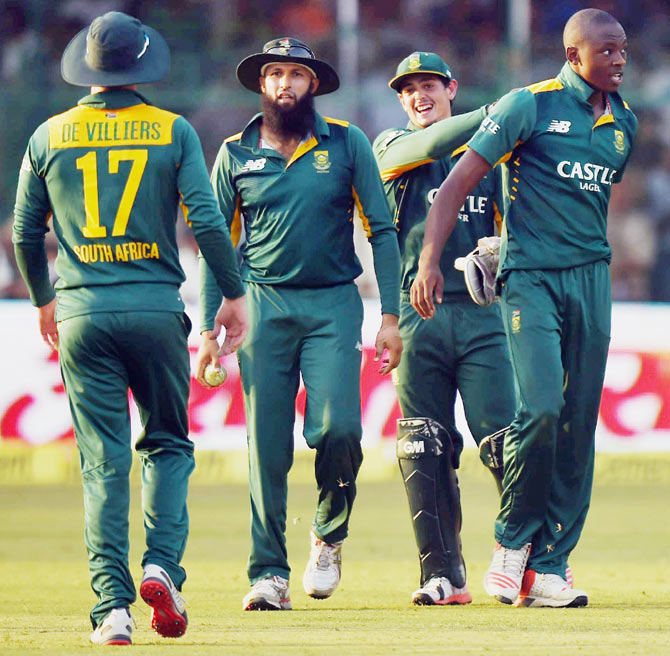 South African players congratulate Kagiso Rabada (right) on taking a wicket