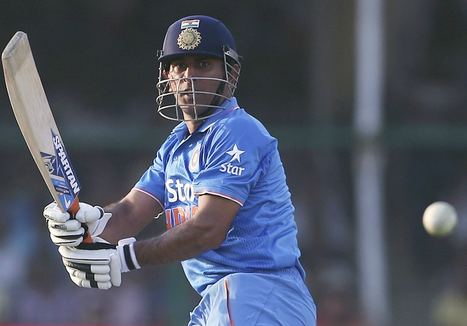 India's captain Mahendra Singh Dhoni plays a shot
