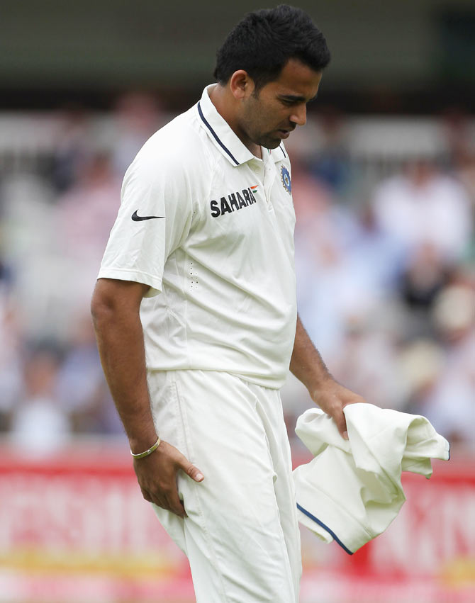 Zaheer Khan limps off with a hamstring injury