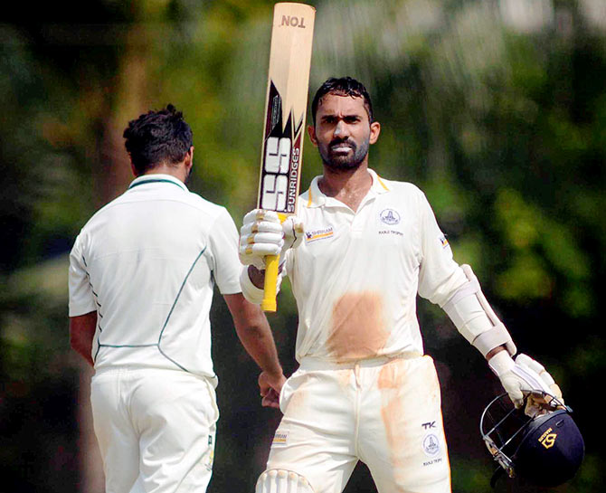 Dinesh Karthik of Tamil Nadu raises bat during his 167 runs against Mumbai