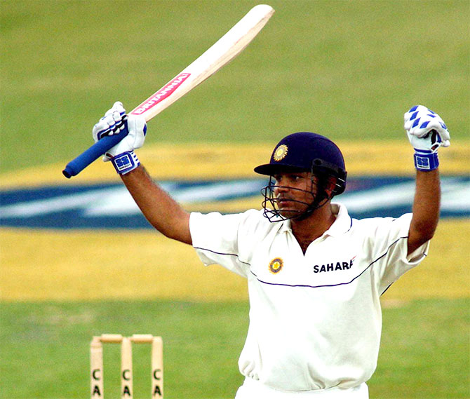Verinder Sehwag of India celebrates a century on his debut