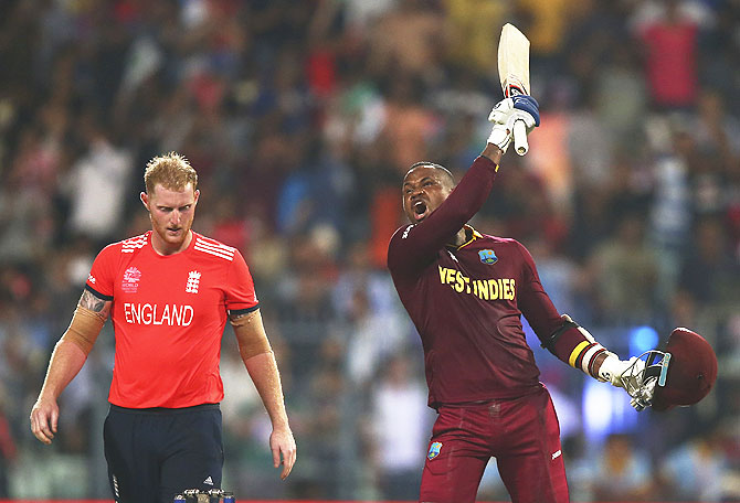 West Indies' Marlon Samuels celebrates after Carlos Brathwaite hit the second six of the last over as England's Ben Stokes looks on during their ICC World Twenty20 Final at Eden Gardens in Kolkata on Sunday