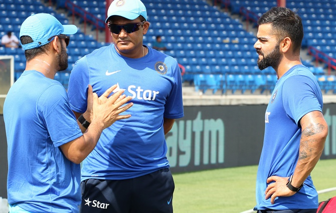 Mahendra Singh Dhoni, left, with Coach Anil Kumble, centre, and Virat Kohli