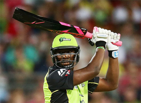 The Sydney Thunders' Andre Russell bats with the controversial black bat during a BBL match