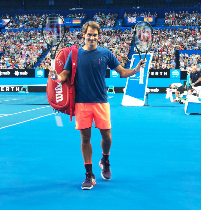 Roger Federer acknowledges the crowd after a practice session in Perth on Thursday