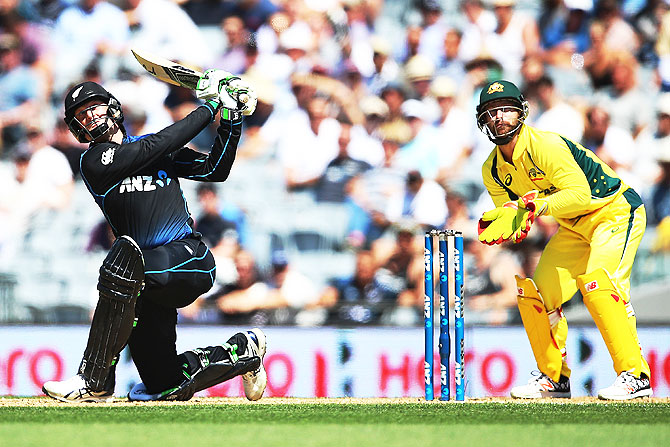 New Zealand's Martin Guptill plays the ball away for six runs