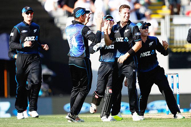 Rediff Cricket - Indian cricket - PHOTOS: Kiwis thrash Australia by 159 runs after Henry, Guptill show