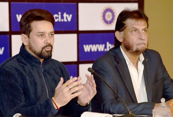 Anurag Thakur, left, and selection committee chairman Sandeep Patil address the media