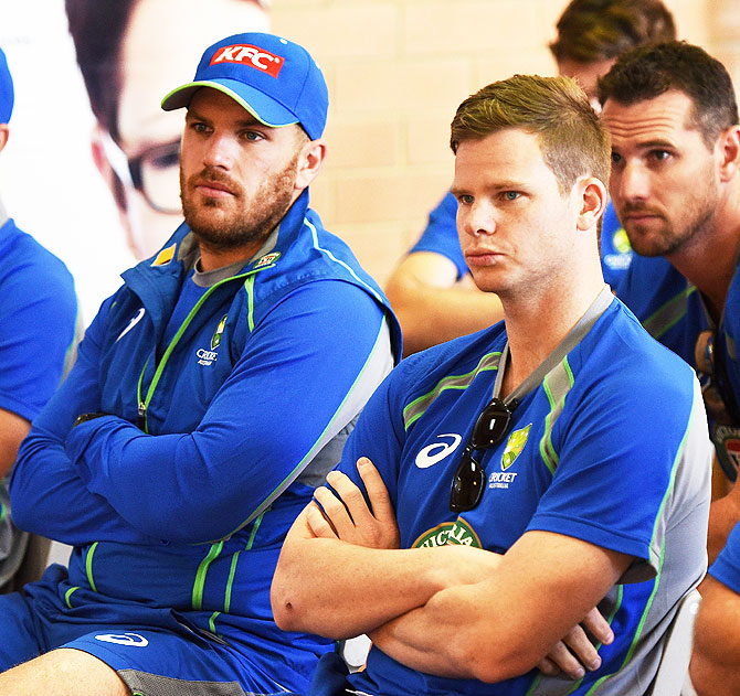 Australia's Aaron Finch and Steven Smith look on during a training session