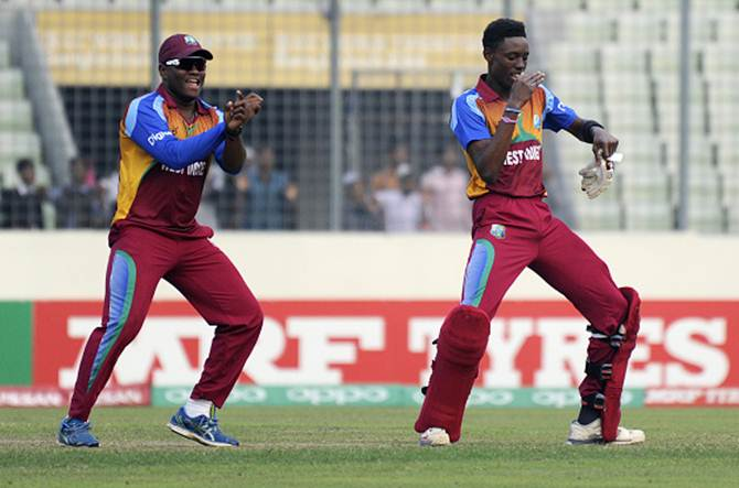 Shamar Springer of West Indies celebrates with teammate Gidron Pope