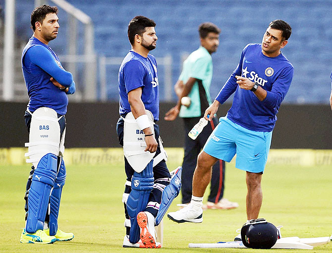 Indian team captain Mahendra Singh Dhoni along with teammates Yuvraj Singh and Suresh Raina during a practice session