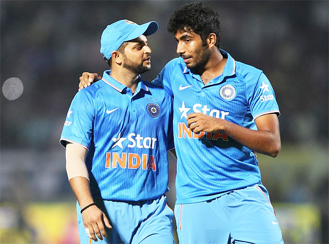 Suresh Raina and Jasprit Bumrah chat between overs