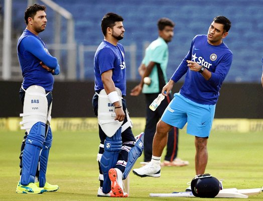 Indian team captain MS Dhoni along with team mates Yuvraj Singh and Suresh Raina during a practice session.
