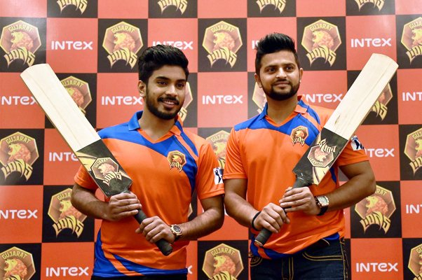 Gujarat Lions owner Keshav Bansal (left) and team captain Suresh Raina