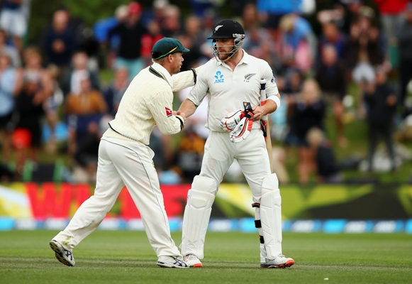 Brendon McCullum of New Zealand is congraulated by David Warner of Australia