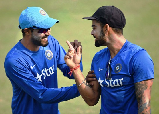 India's Virat Kohli share a light moment with Ravindra Jadeja