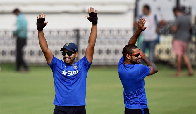 India's Rohit Sharma with Shikhar Dhawan during a practice session
