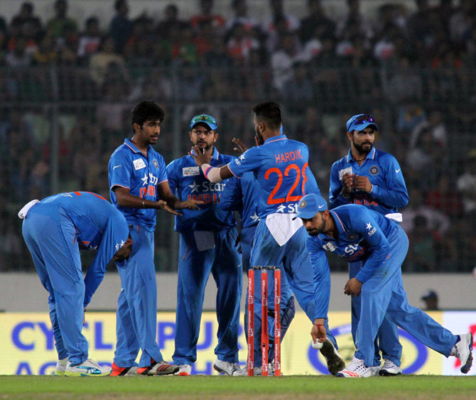 Indian players celebrate the wicket of Bangladesh's Soumya Sarkar during the first match of the Asia Cup Twenty20 tournament in Dhaka on Wednesday