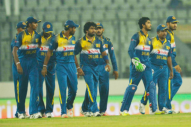 The Sri Lanka cricket walk off the field after beating UAE by 14 runs in the Asia Cup Twenty20 on Thursday