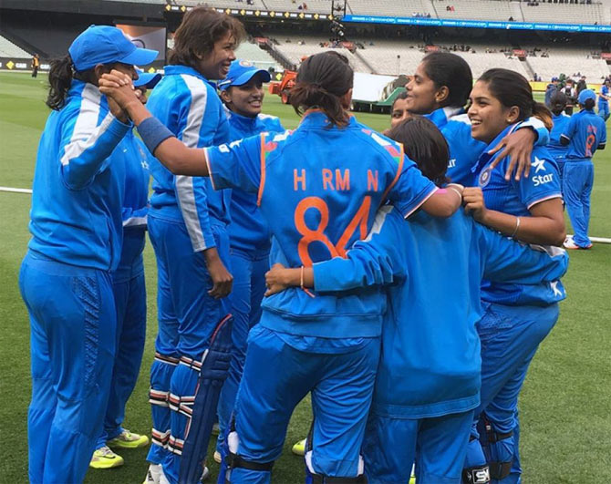 The Indian women's cricket team celebrates after winning a match