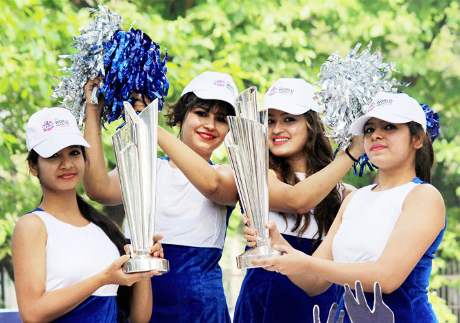 Models display the ICC T20 World Cup Trophy during an event for its public viewing in Nagpur on Saturday
